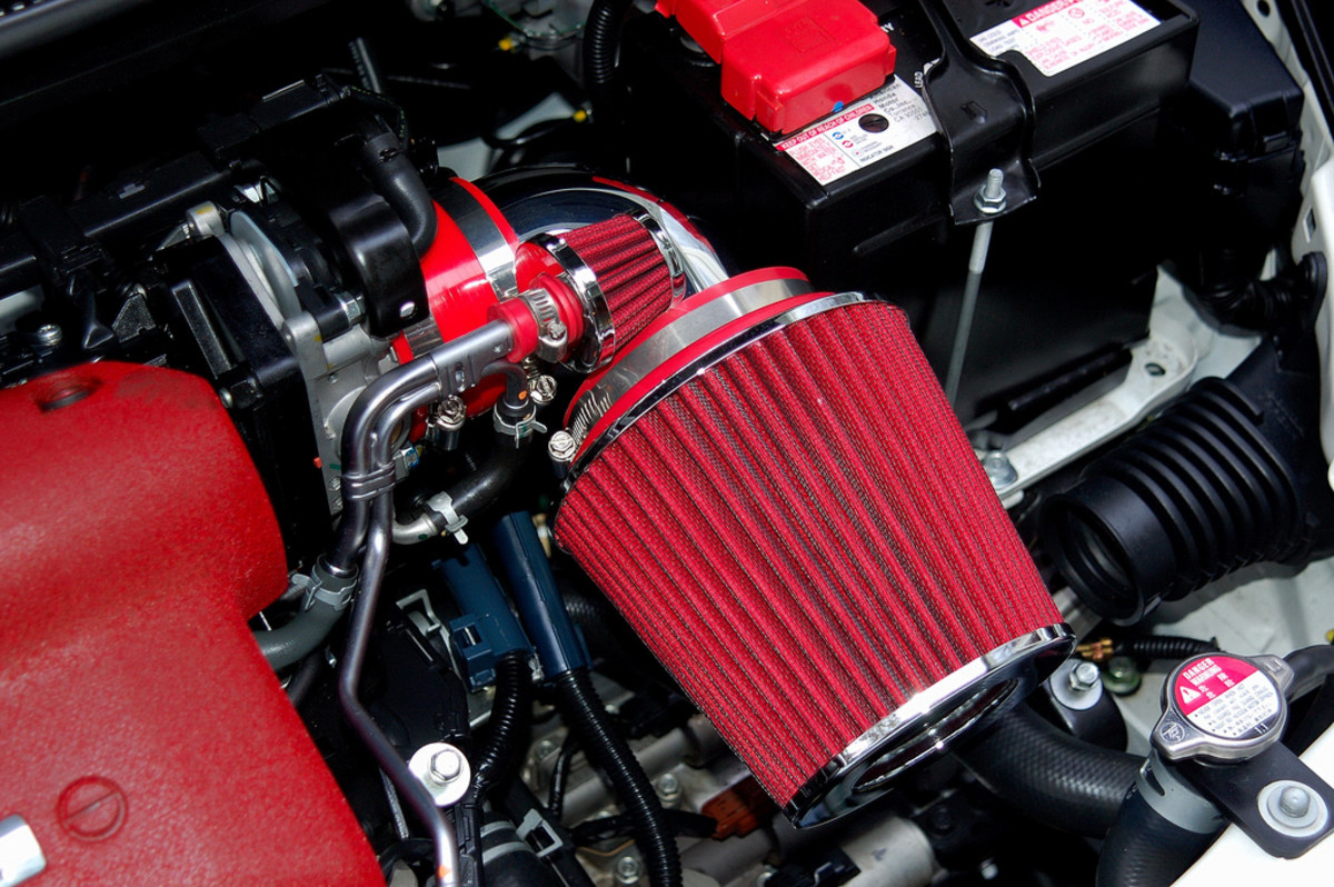 Short RAM intake with a red silicone intake coupler.