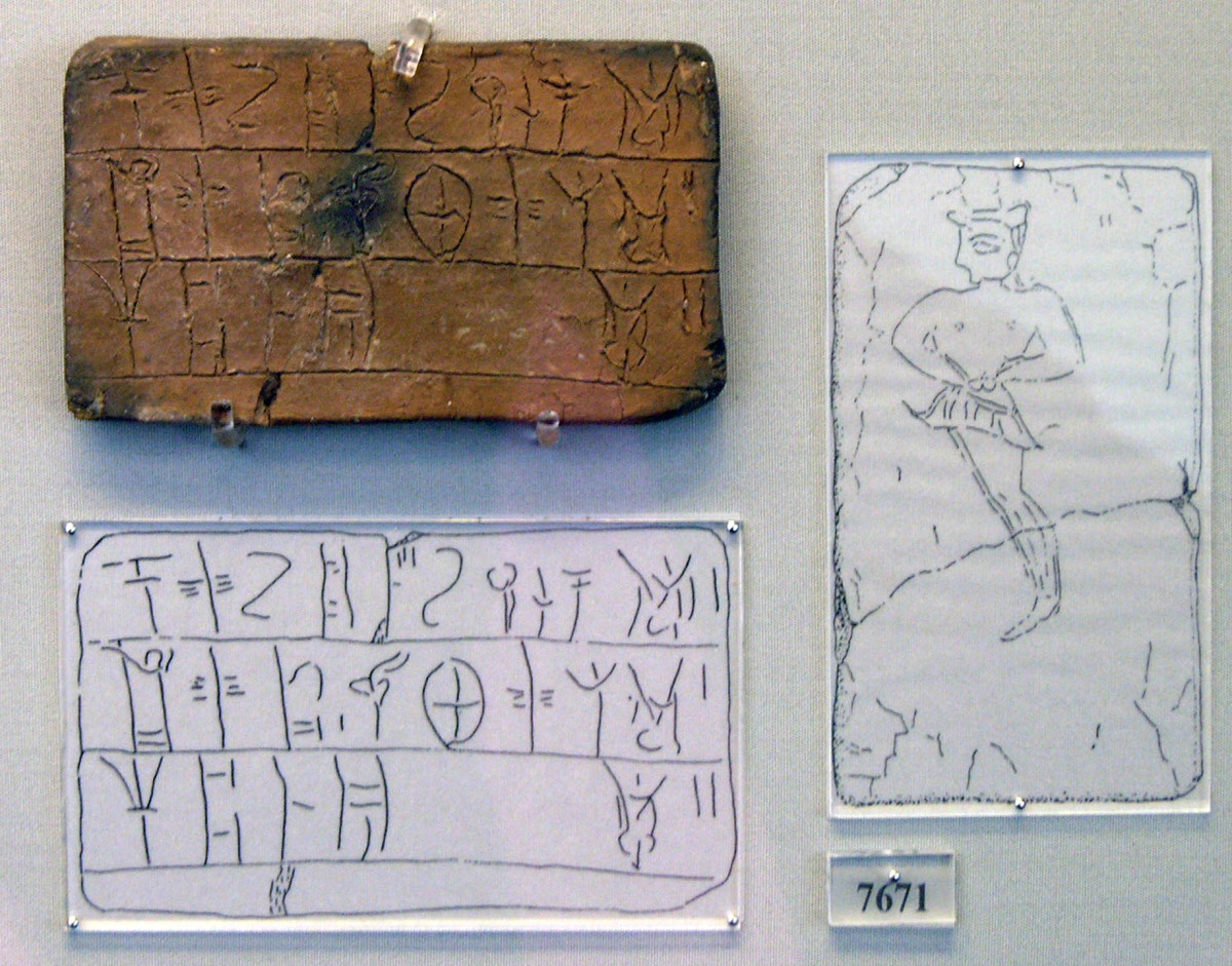 Tablet is inscribed in Linear B. The tablet comes from the House of the Oil Merchant. The tablet contains a register of an amount of wool to be dyed.