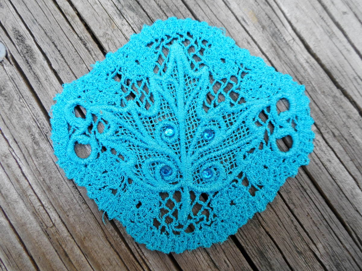 "A hair piece, meant to be used with a hair stick, done using Sulky lace. From the ""Evenfall"" collection by Urban Threads"