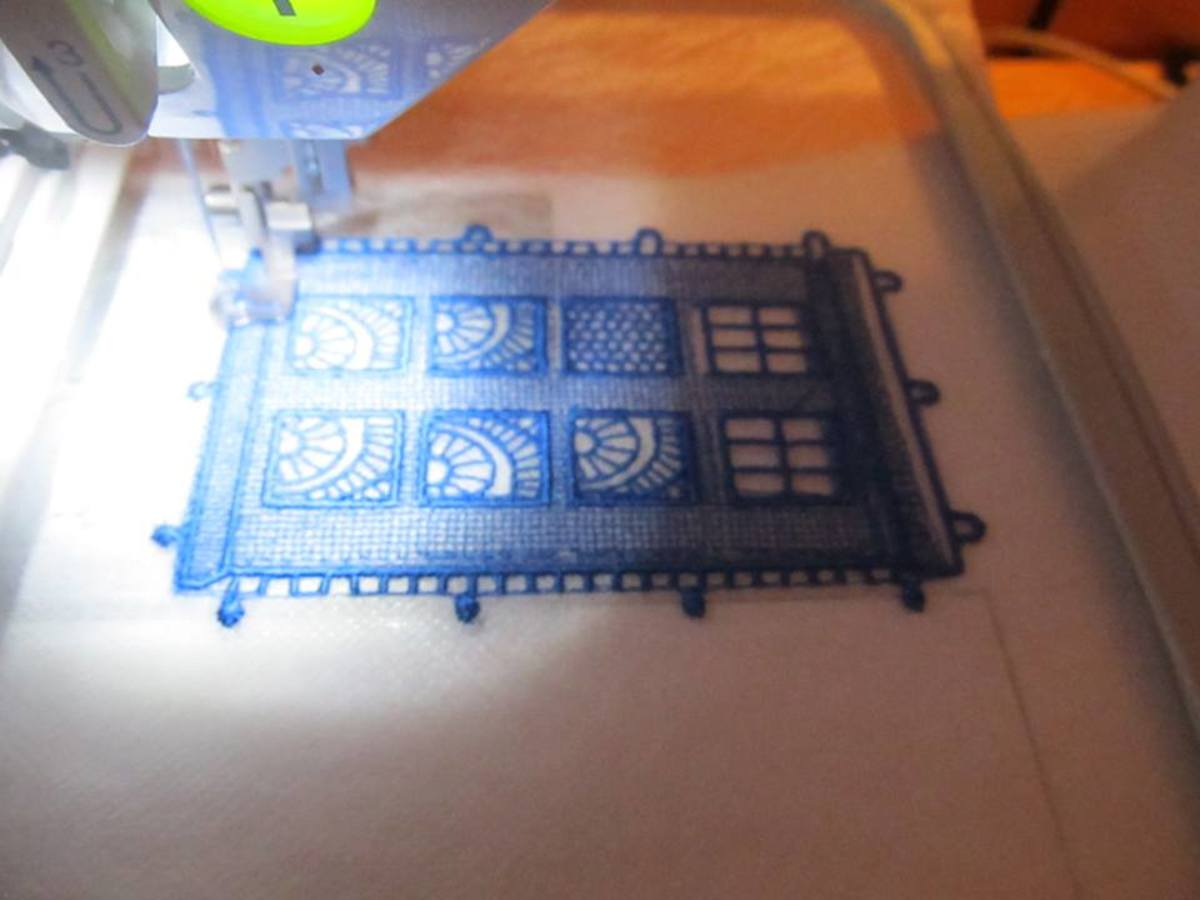 Lace TARDIS being created on a PE700II using one layer of Fabri-Solvy