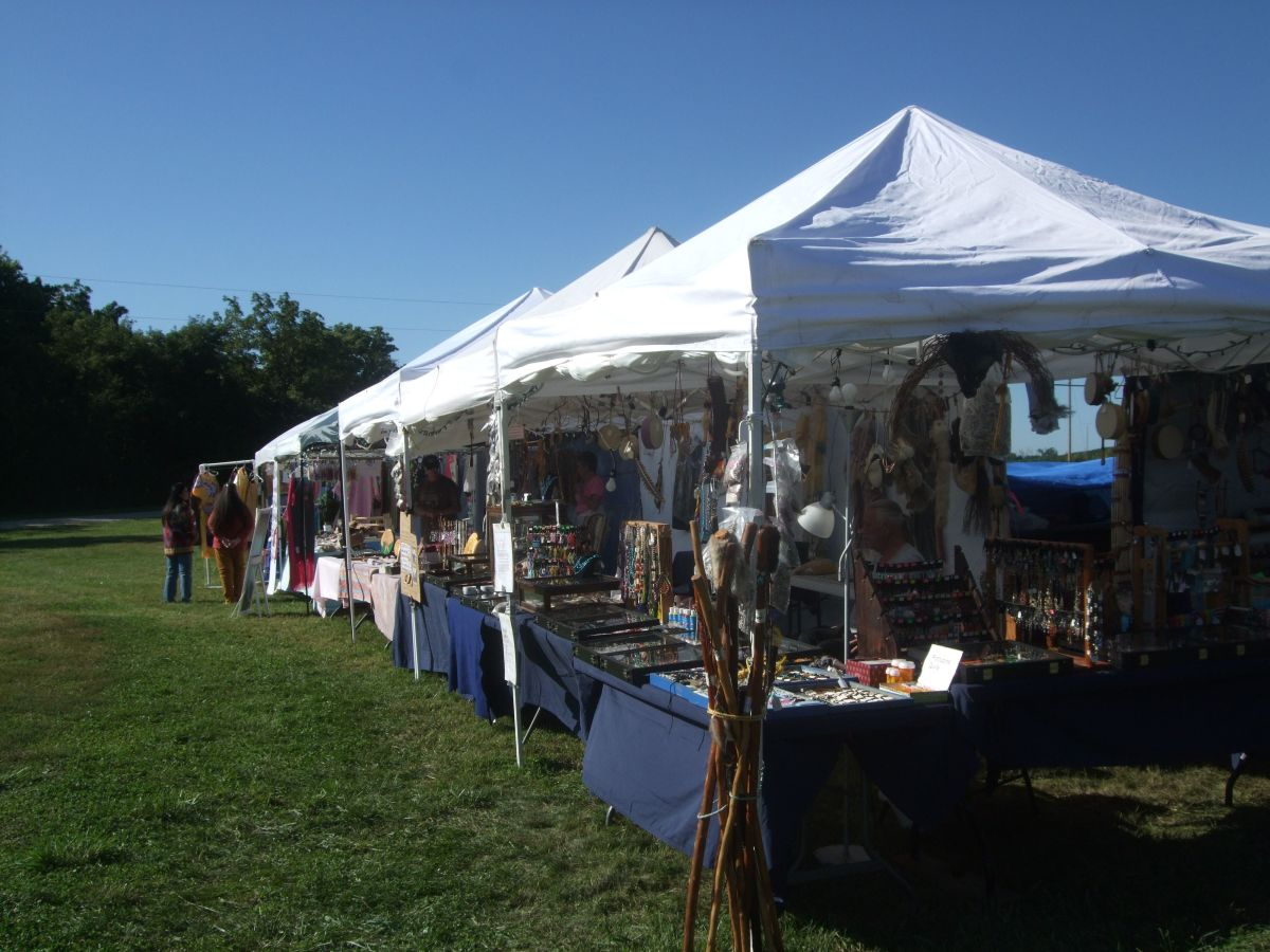 Photo of our booth set up at White Cloud Pow Wow. It is now 10 feet by 68 feet long, and absolutely full of wonderful finished Regalia.
