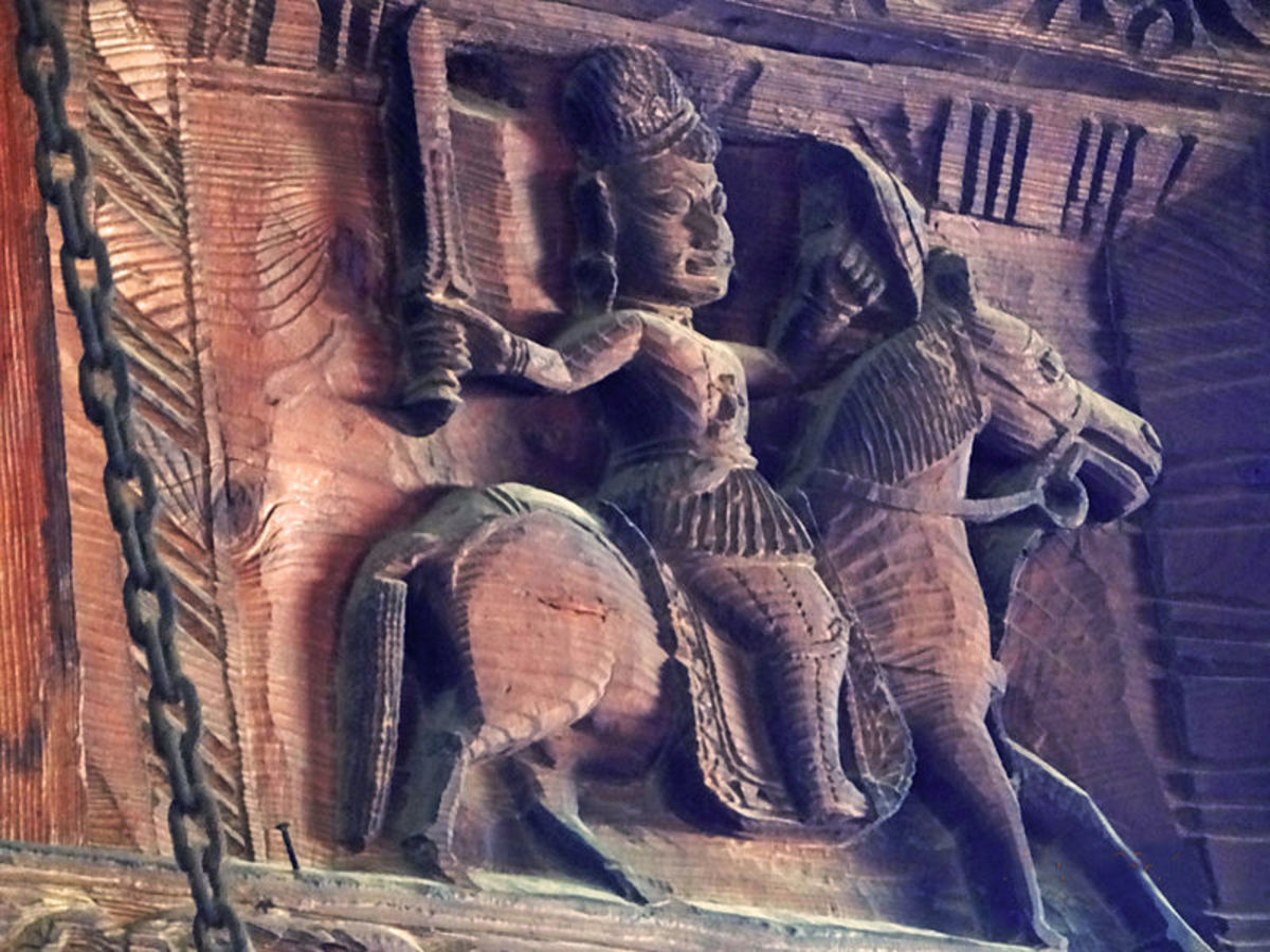 A carved statuette of a primitive warrior on a wooden wall of the Hidamba Devi temple at Manali