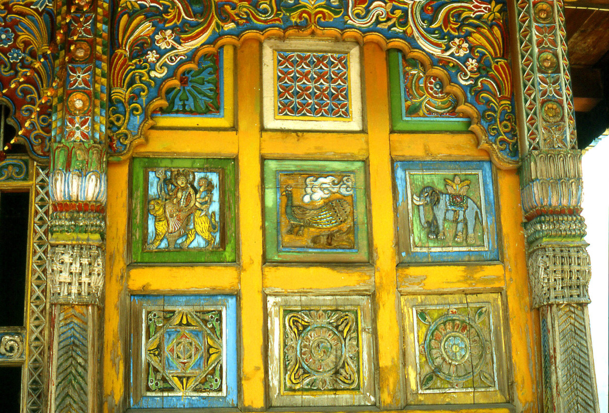 Paintings on a carved door