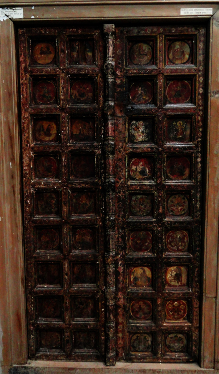 Wood carved door at Chamba