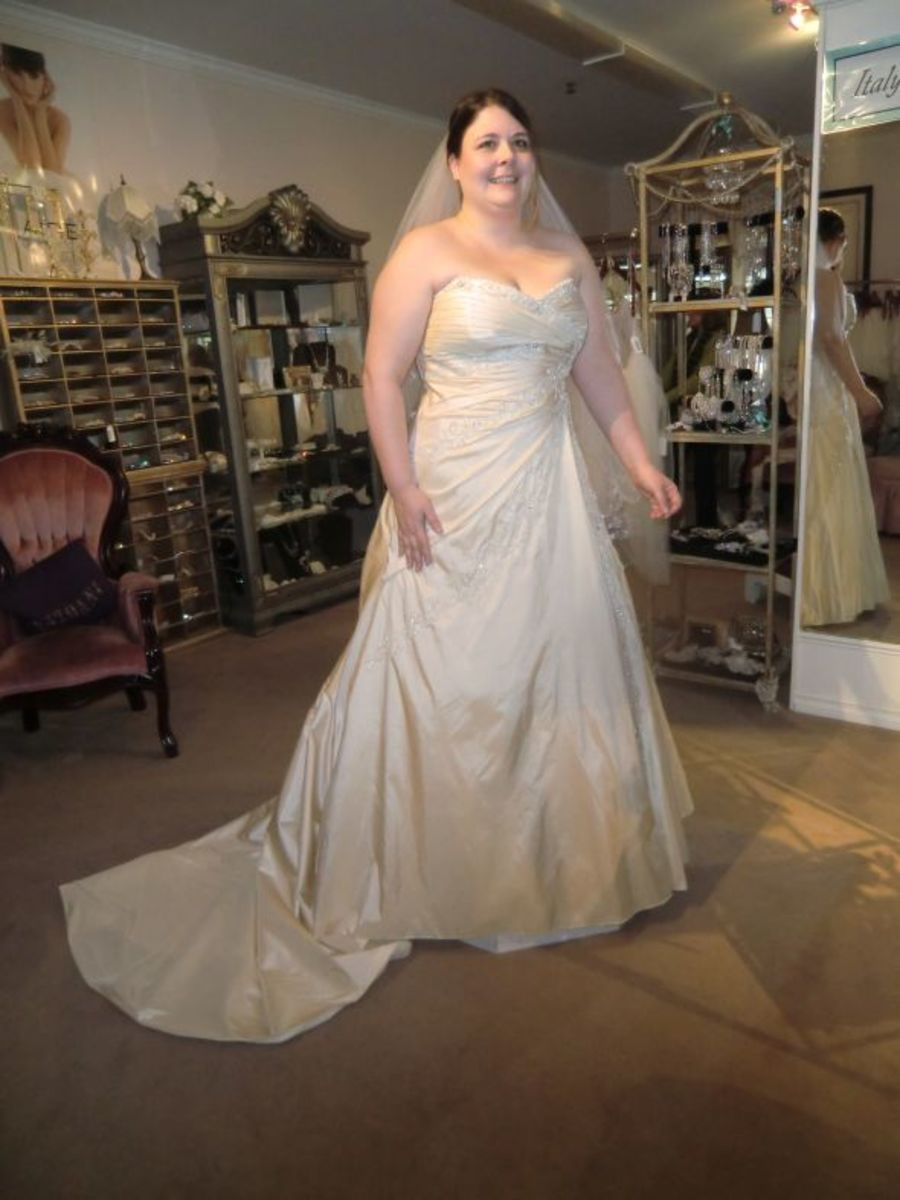 A bride in a Sophie Tolli wedding dress in 2012.