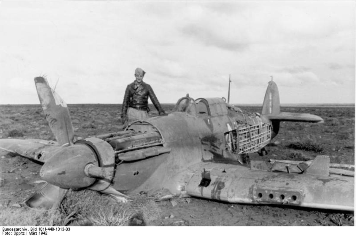 Marseille standing next to one of his victories.  He would often return to the crash sites of planes he shot down and help survivors.