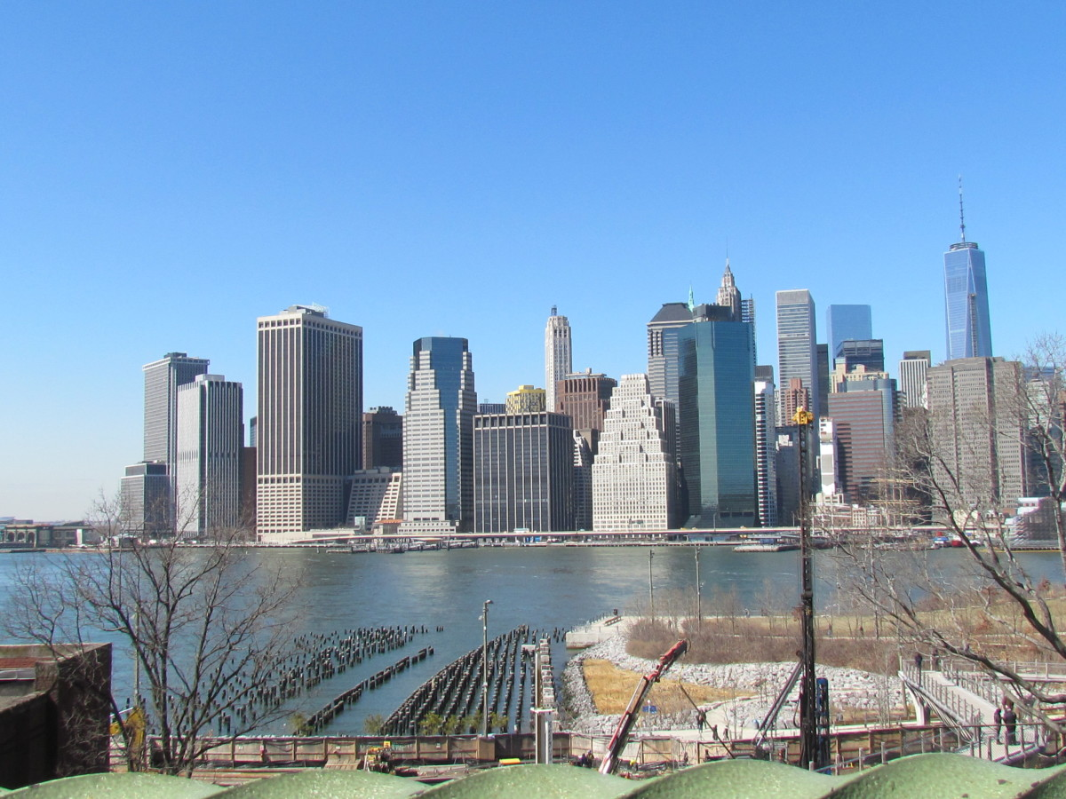 Standing on the Brooklyn side of New York, a captivating picture of the city under the blue skies.