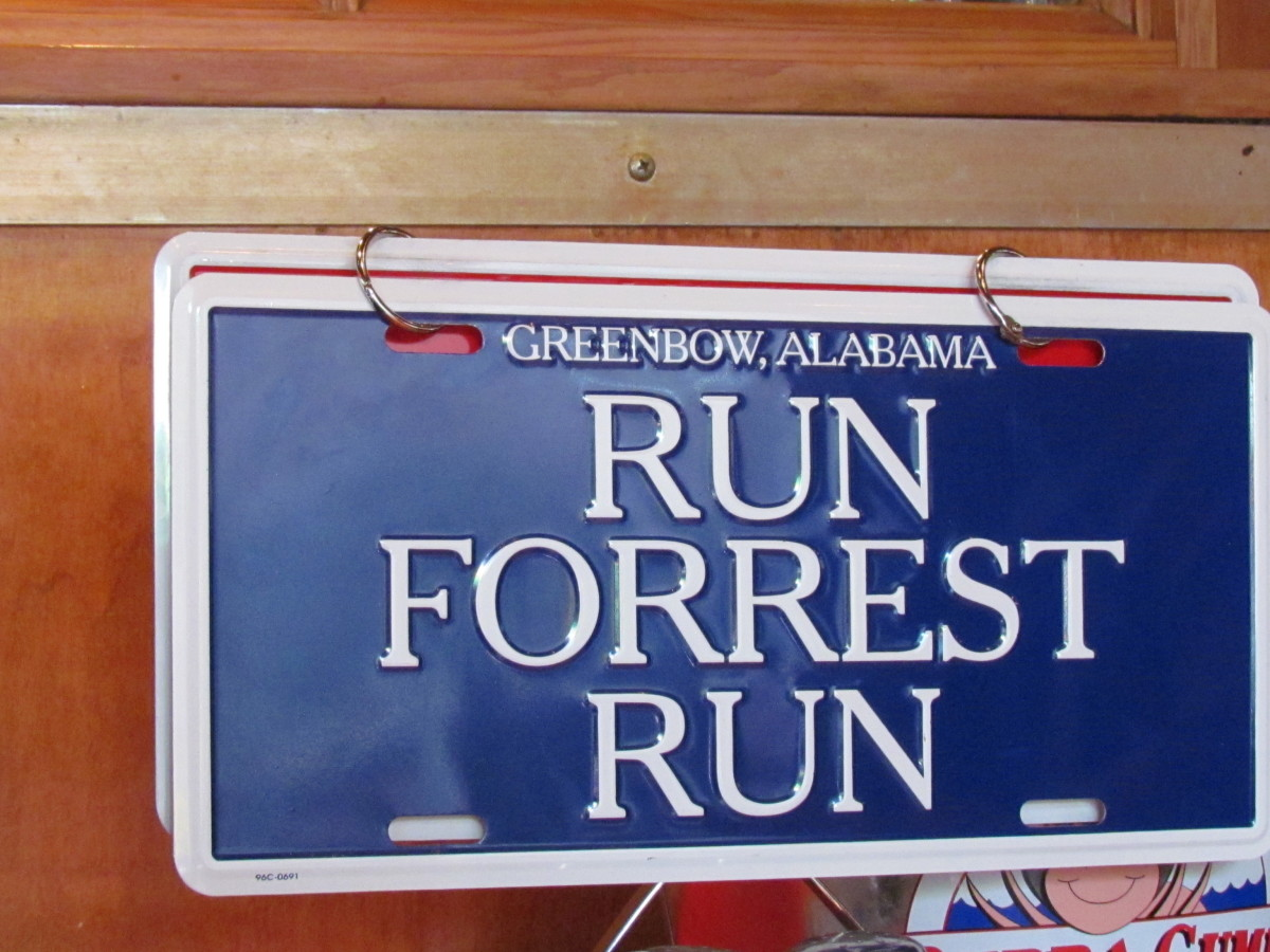 """The very popular line from the movie, """"Forrest Gump"""" which helps to inform the waitress of your needs. There is also a red sign that says, """"Stop Forrest Stop."""""""