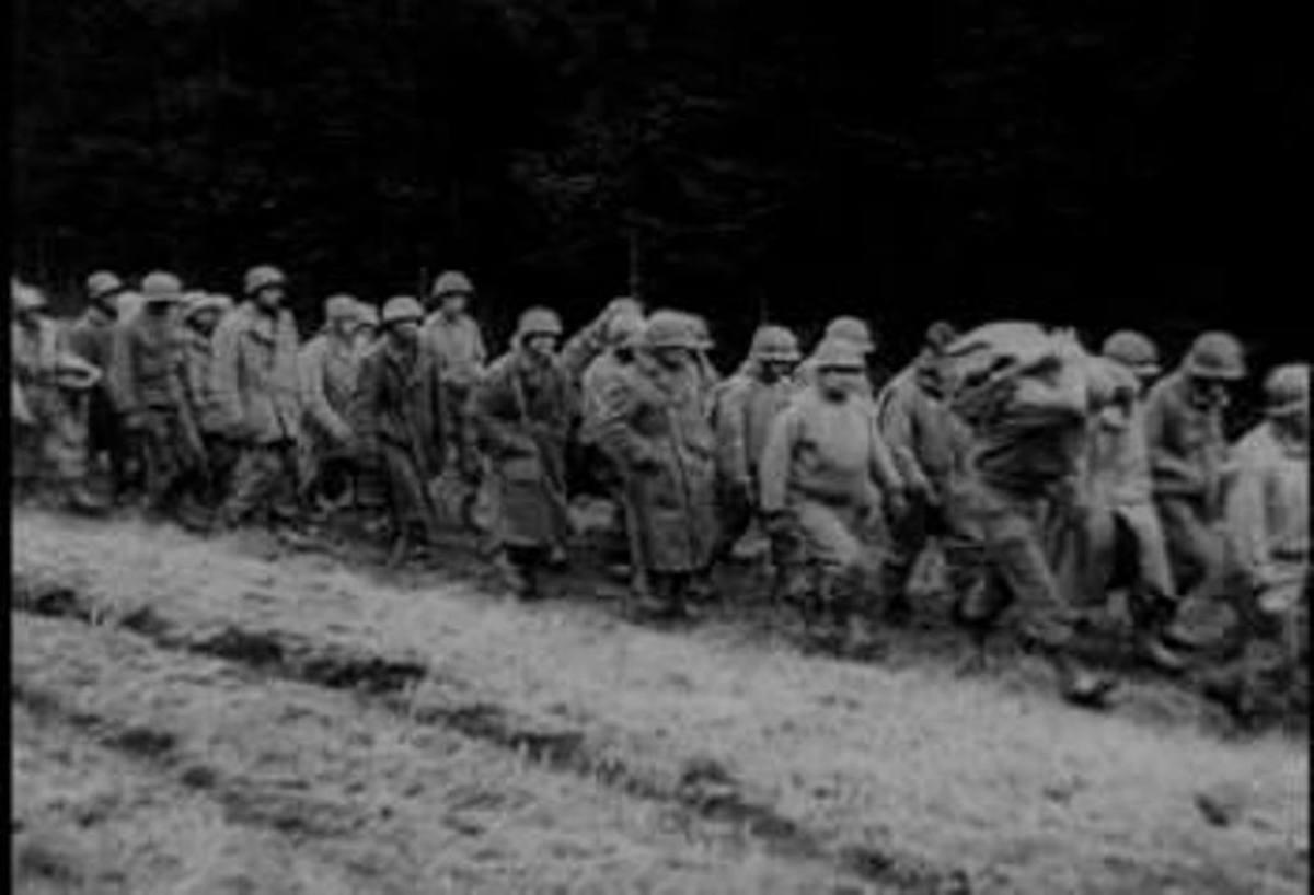 December 19, 1944:  Men from the 106th ID march east. (newsreel still)