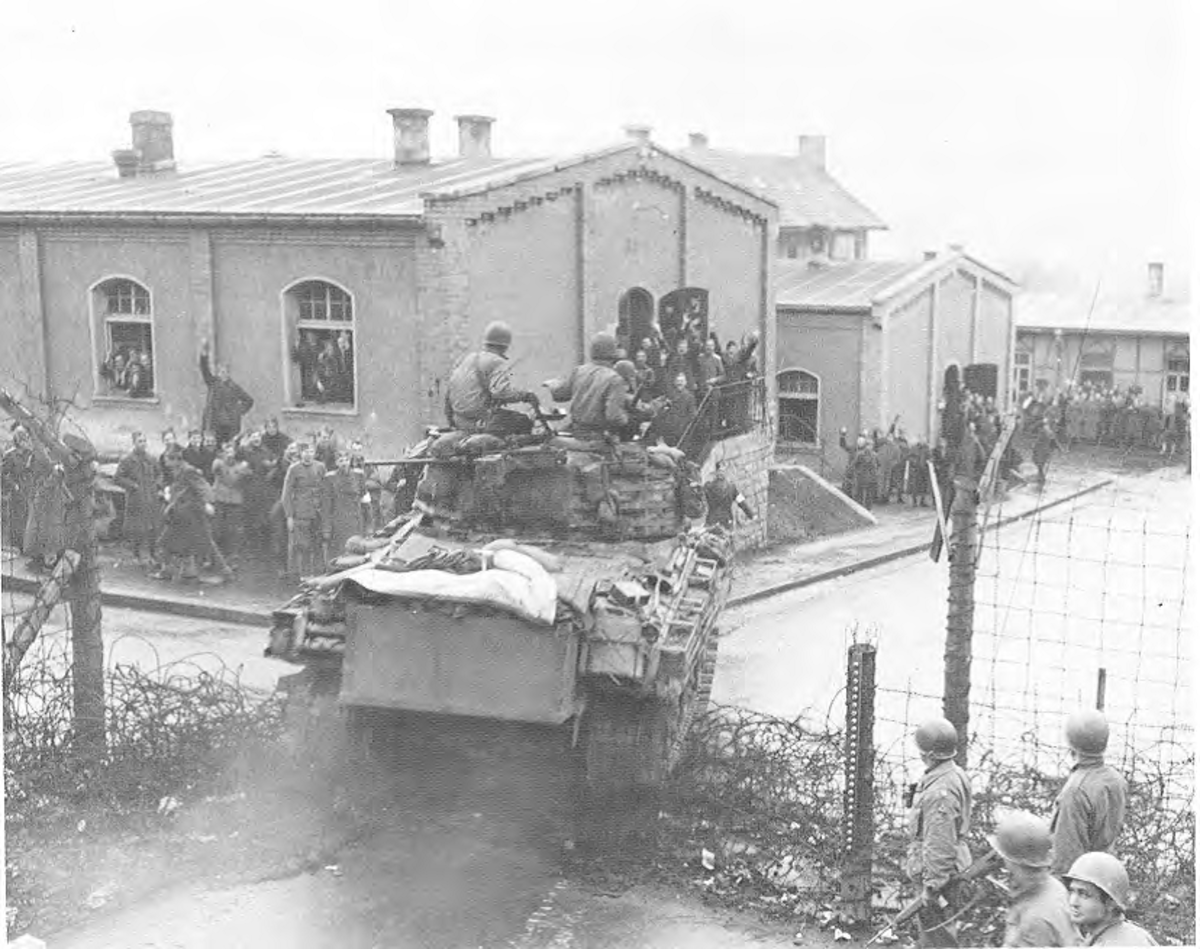 Liberation at last! April 6, 1945.  A 14th AD Sherman plows through the gate of the Stalag XIII-B.
