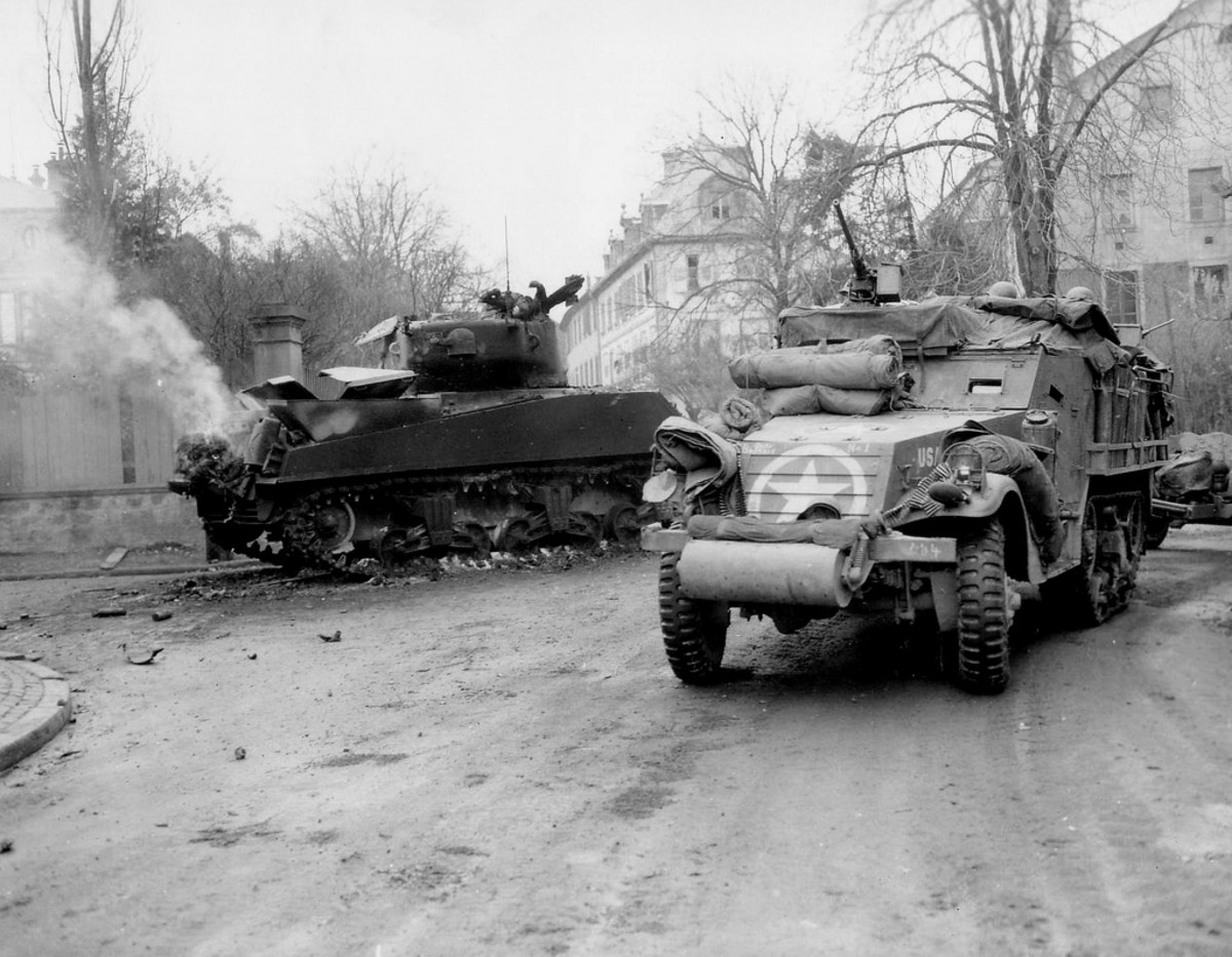 April 1945: Help is on the way. A unit of the 14th Armored Division fighting their way through a German town, just west of Hammelburg.