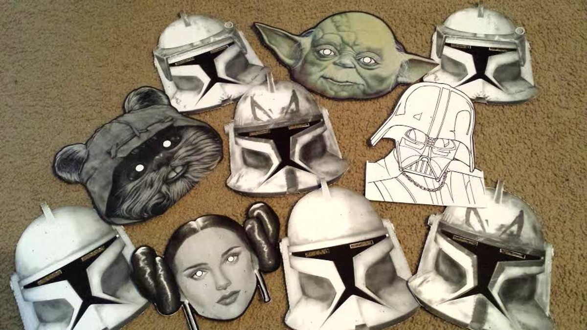 Get familiar with the characters.  You can find free Star Wars masks online for your costume or to wear for a photo booth at your Star Wars party.  I attached popsicle sticks to these for picture props but you can tie a string around them to wear.
