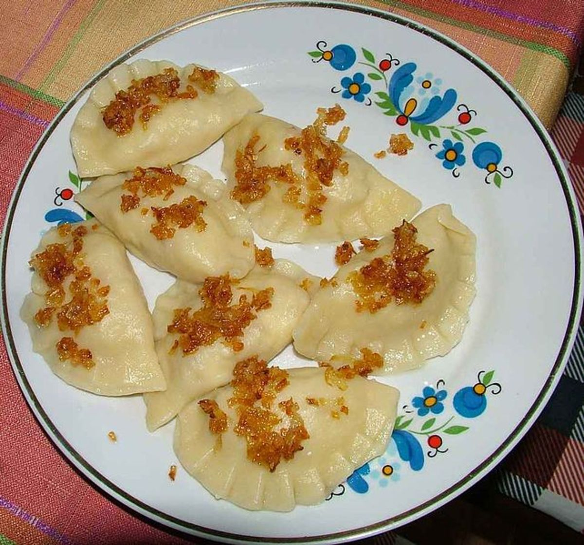Pierogi with fried onions.