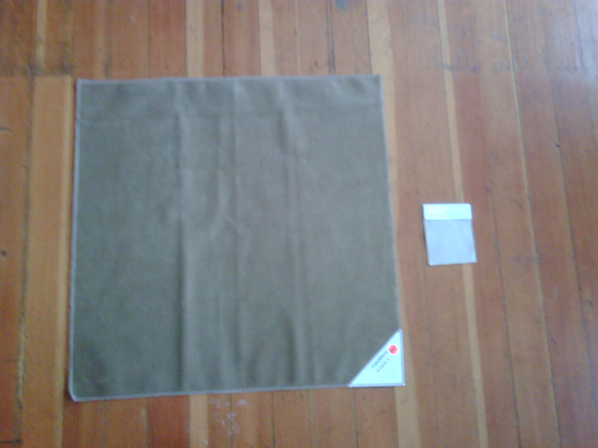 Here is the large fabric swatch compared to the small sized swatch - not the same colors, but gives you an idea of size