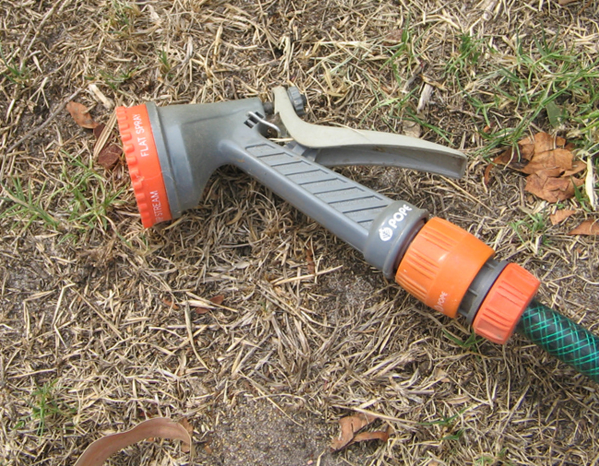 Trigger sprinkler only approved devise for watering by hand.