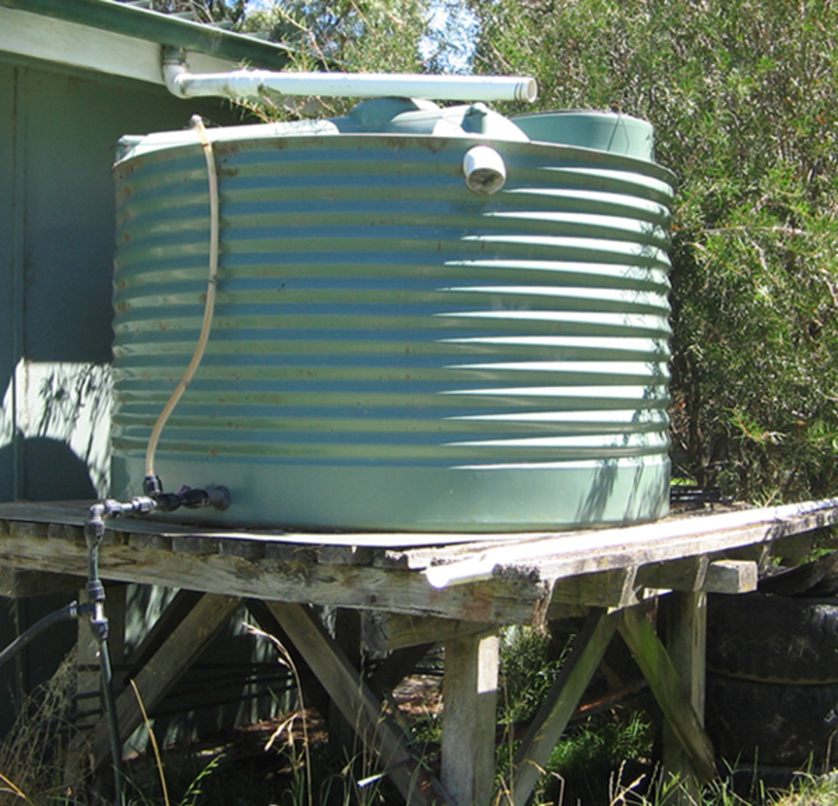 Water storage tank raised on a platform to allow more gravity pressure.