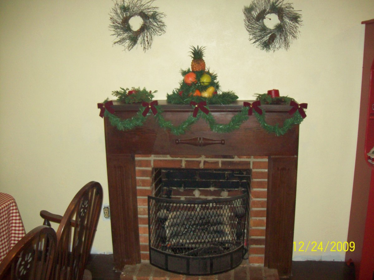 A walnut mantel and surround in an Early American design.