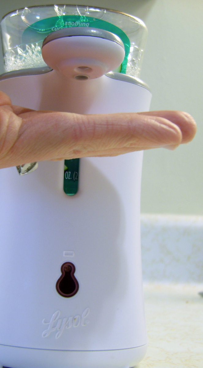 Use caution when dispensing to ensure that your hand is not touching the dispenser arm. Soap buildup will cause the sensor to stop working and the red light will blink continuously until it is cleaned.