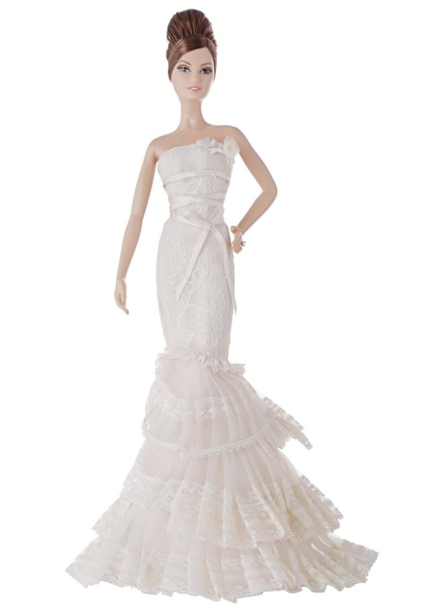 Barbie doll in long elegant white lace dress