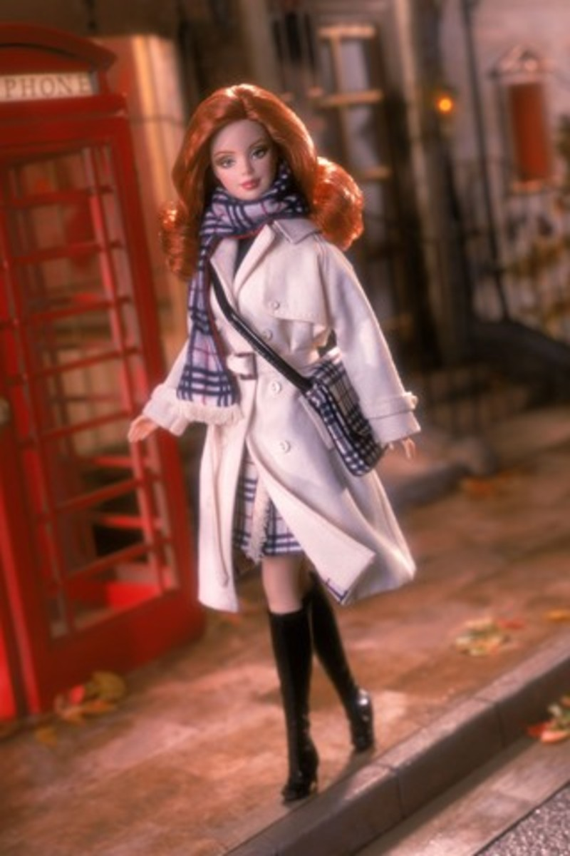 Barbie doll in classic trench coat and purse and scarf
