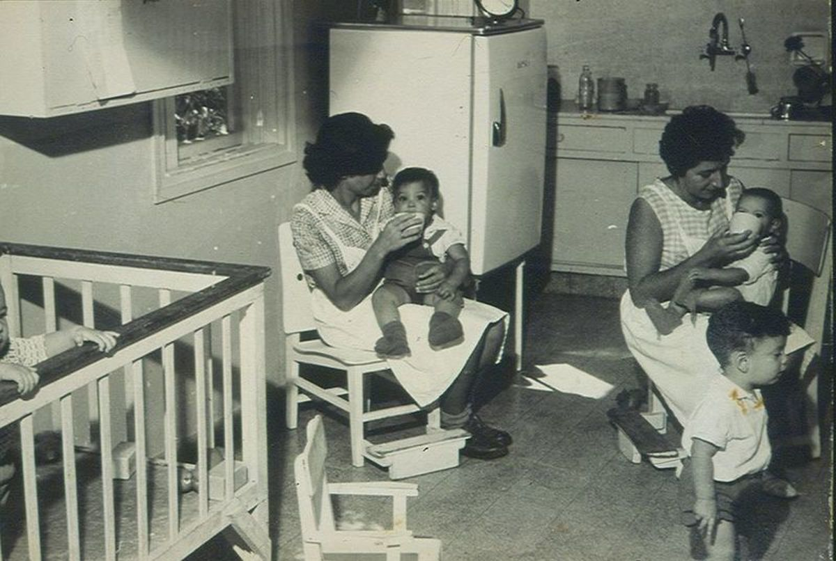 "During the early period of Kibbutzim, primary caregiver took care of children in place of parents. The children lived in what was referred to as the ""Children's House"""