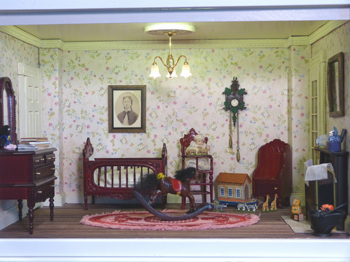 A one-room miniature art of a Victorian style home's nursery. Notice the little baby sitting in a high-chair, the crib, and a rocking horse.