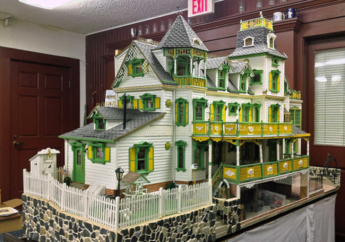 A Victorian style miniature home with details typical of the 19th century Victorian era home of the wealthy.