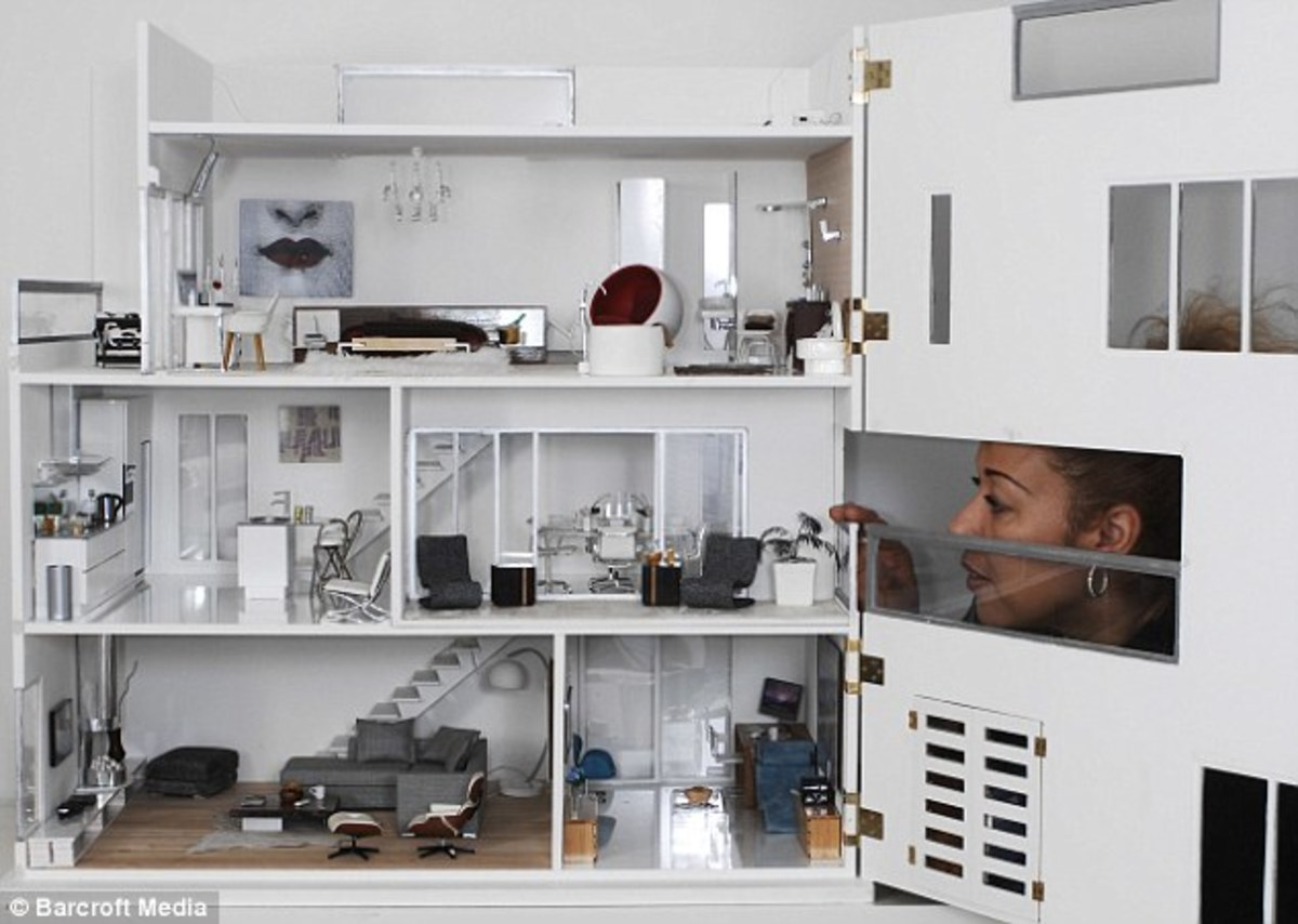 A modern design of a miniature dollhouse with well crafted  furniture and furnishings