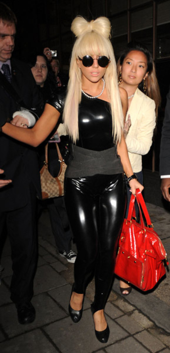 Wearing a skintight latex bodysuit for a Friday night in London for 'The Scott Mills Show' on Radio 1.