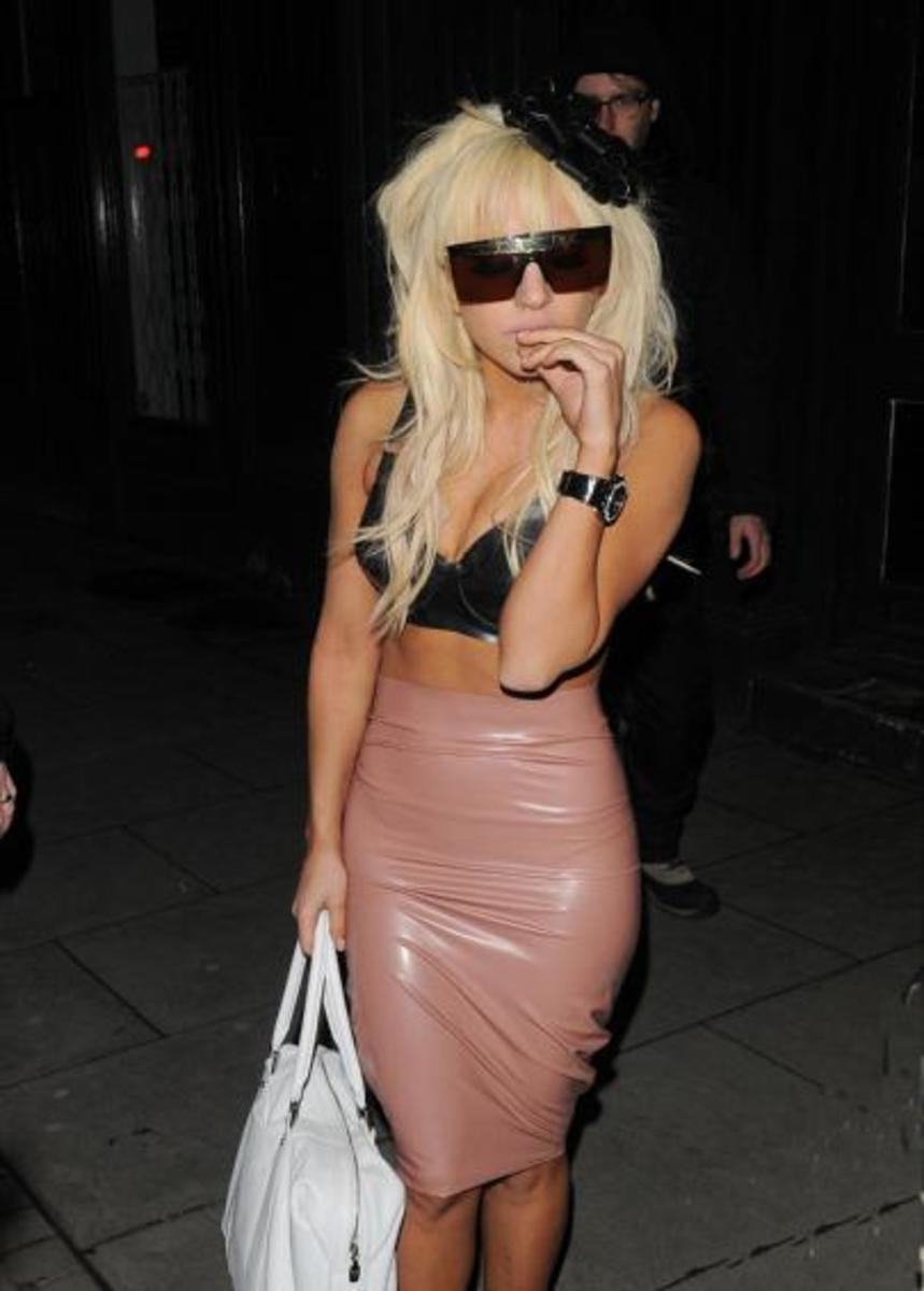 Coming out of a night club wearing a latex skirt and bra