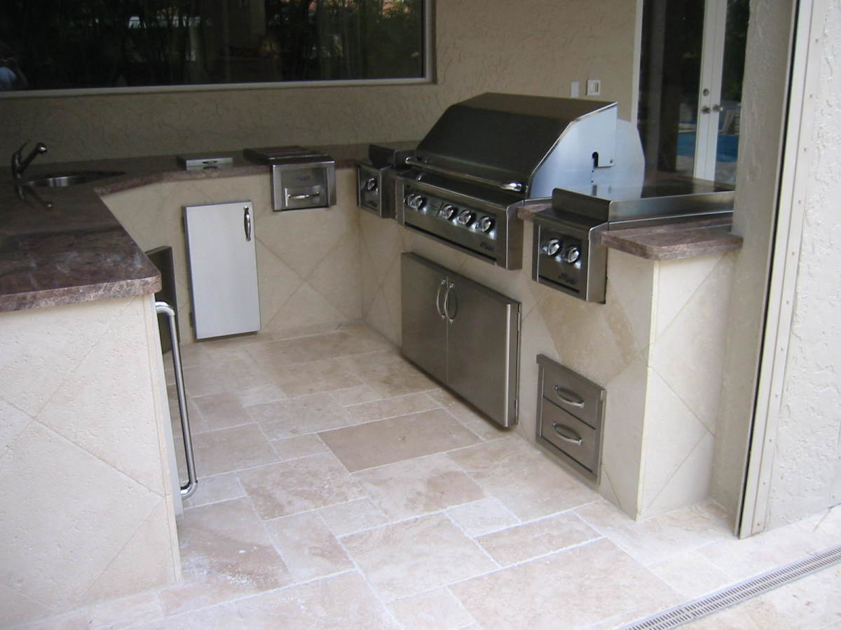 Alfresco built in gas grill with built in accessories including access door, drawers and outdoor refrigeration.