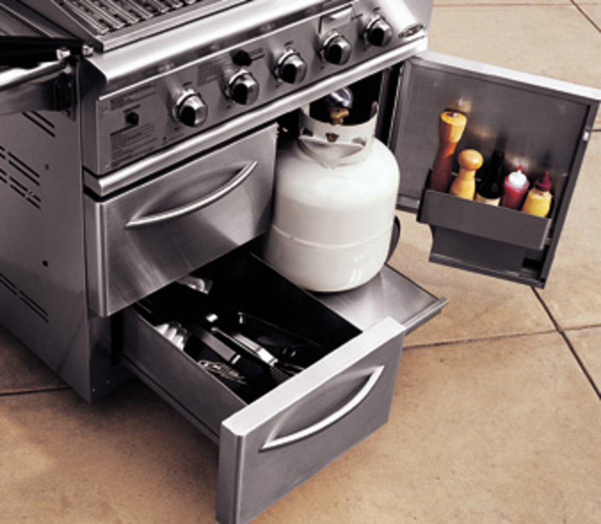 The dcs 36 and 48 inch grills had portable carts with propane tank drawers and storage drawers.