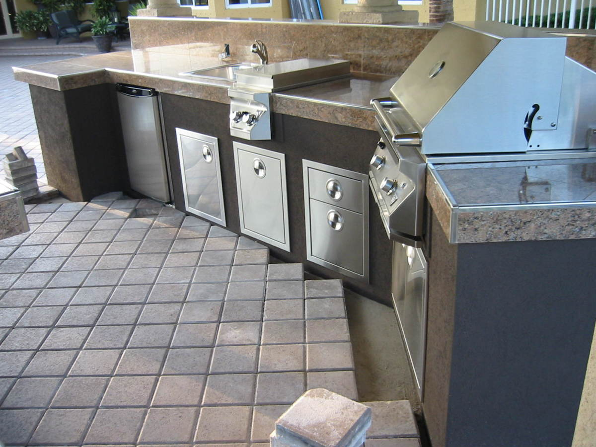 Twin Eagles built in bbq grill and built in access doors and drawers.  I like the stainless coping here we used to create a finished look to the granite tiles. This was the only one we did this way -- a lot of work!