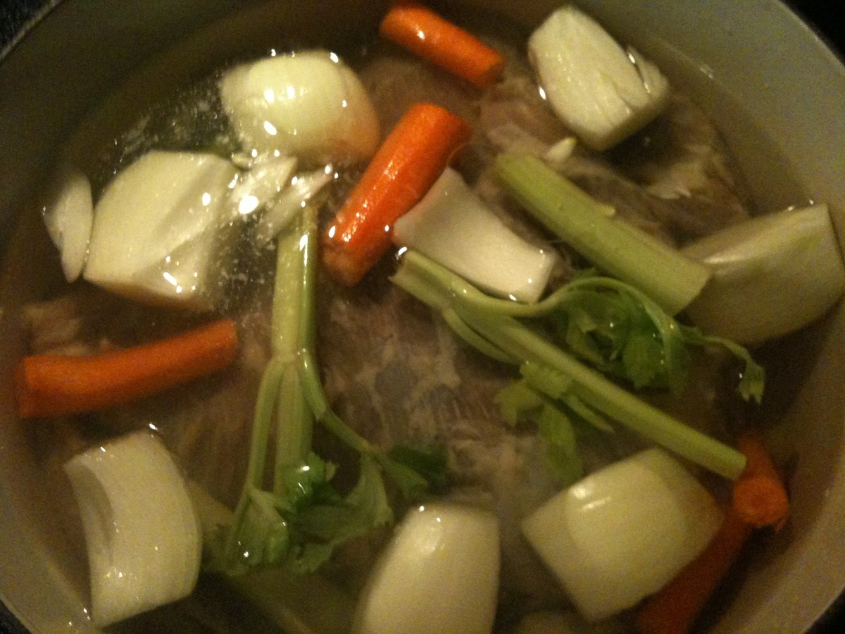 Brining done, the brisket hits the stockpot with some veggies to simmer.