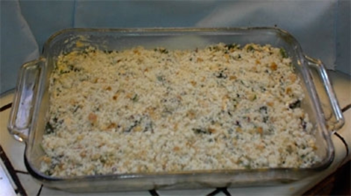 Spread the bread crumbs or wheat germ evenly so they cover the mixture.  Put in oven and cook for 45 minutes or until firmly set and brown on top. Test with toothpick.