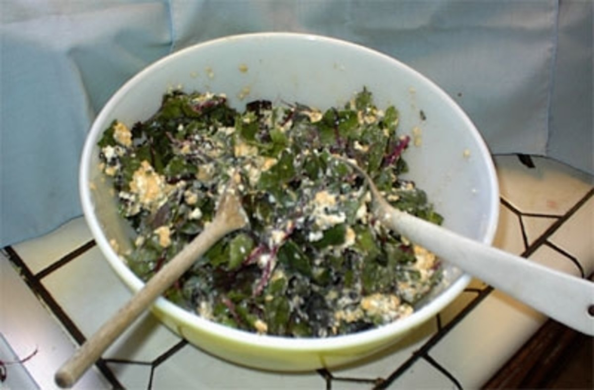 Now that you have a big enough bowl, toss the chard with the egg-cheese mixture like a salad until it appears most of the leaves are coated with the mixture.