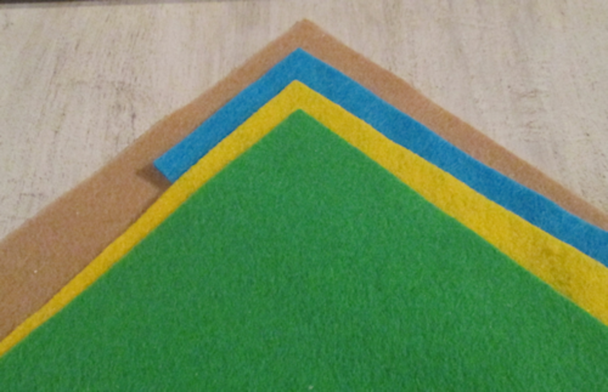 I had some scrap felt I could use for various features of the golf hole. I used tan, blue, lime green and yellow.