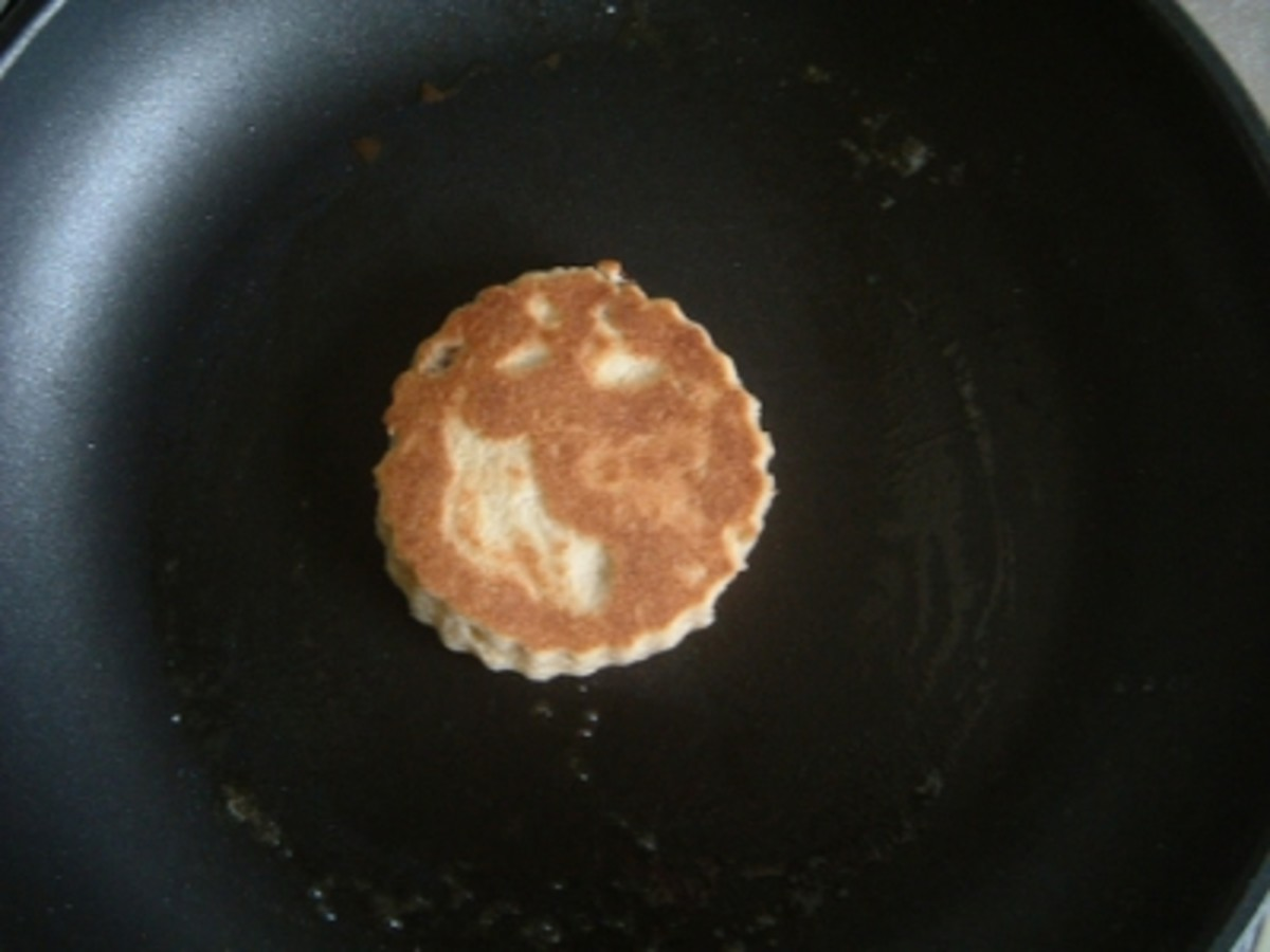Cook the Welsh Cakes on a lightly greased bakestone or heavy based frying pan (skillet) until they are golden brown on each side
