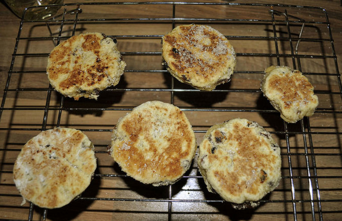 When cooked place your Welsh Cakes on a cooling rack and while they're still hot, sprinkle them with sugar