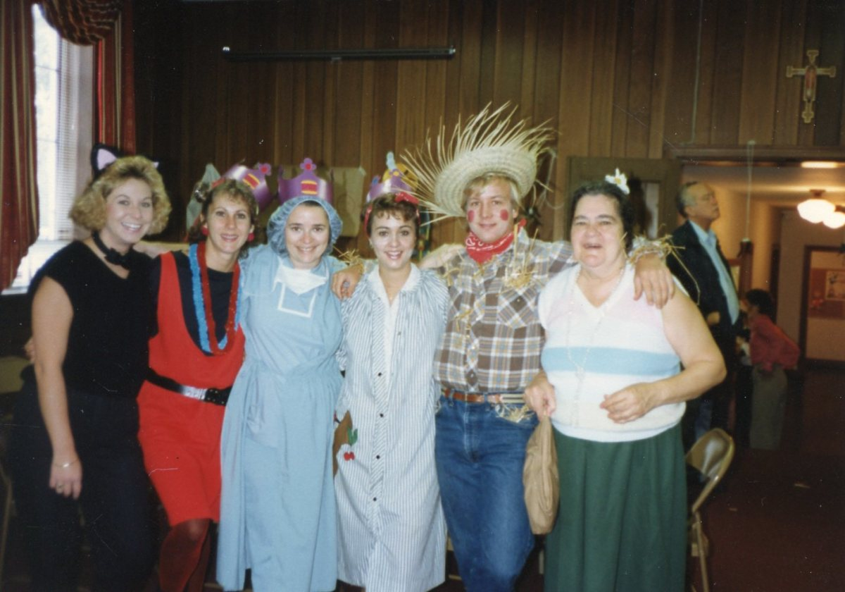 Elizabeth in cat costume, Marsha as punker, me in scrubs, Cathy as domestic goddess and Mike as scarecrow.