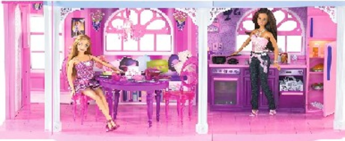 Barbie in her kitchen while her friend sits at the dining table waiting for a snack.