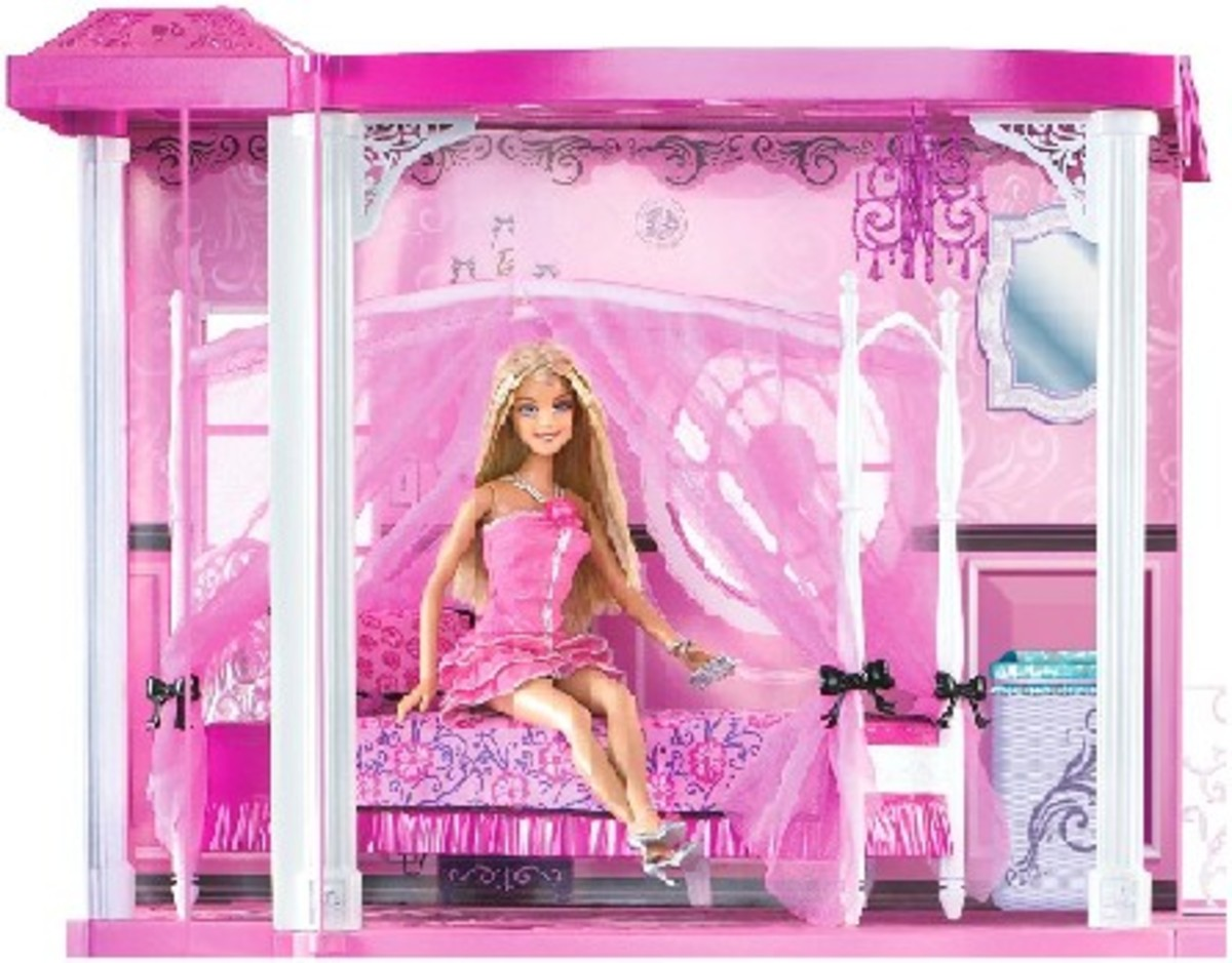 Time to go to bed? Here is Barbie, sitting on her luxury four-poster bed in her beautiful pink scheme master bedroom..