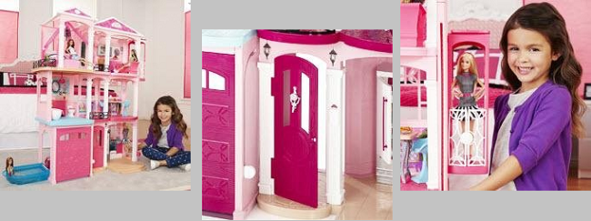 This is the interior of the 3-storey Barbie house showing a young girl by her townhouse dolls house, the elevator door, and her holding a box with a Barbie doll in her hands.