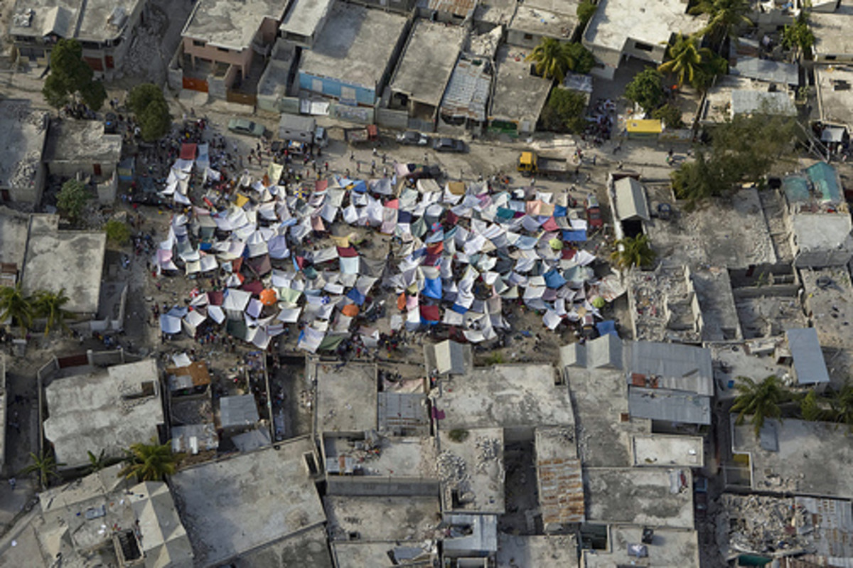 People living in tents after an earthquake.