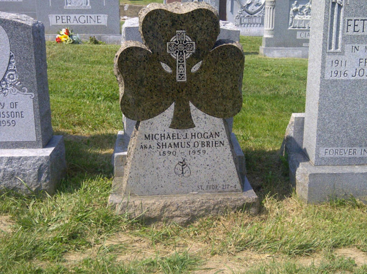 Donated Tombstone for Michael J. Hogan who fought as 'Yonkers Favorite' Shamus O'Brien. The green tombstone is in the shape of a shamrock and features a Celtic Cross and a pair of boxing gloves. His grave is located in St. Joseph Cemetery in Yonkers,