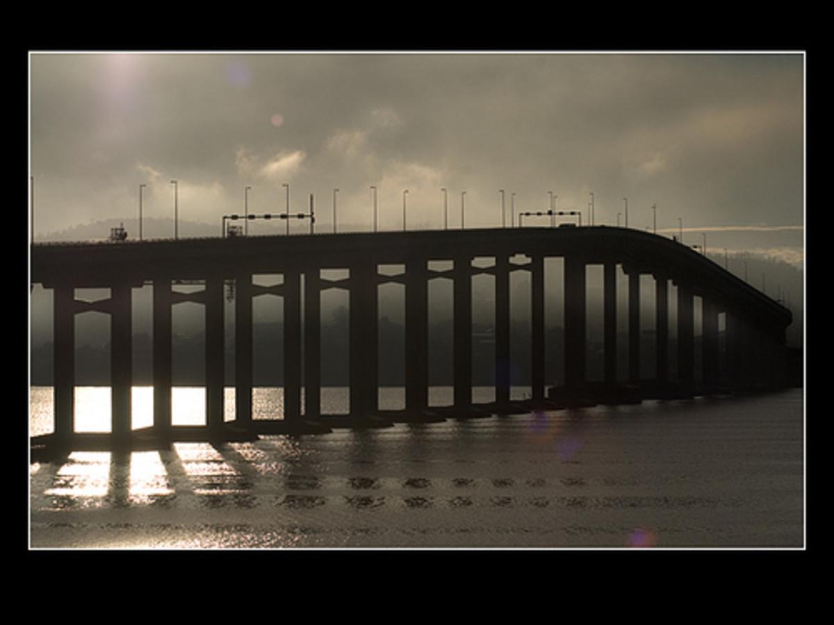 The reinforced concrete bridge on a darkening night.