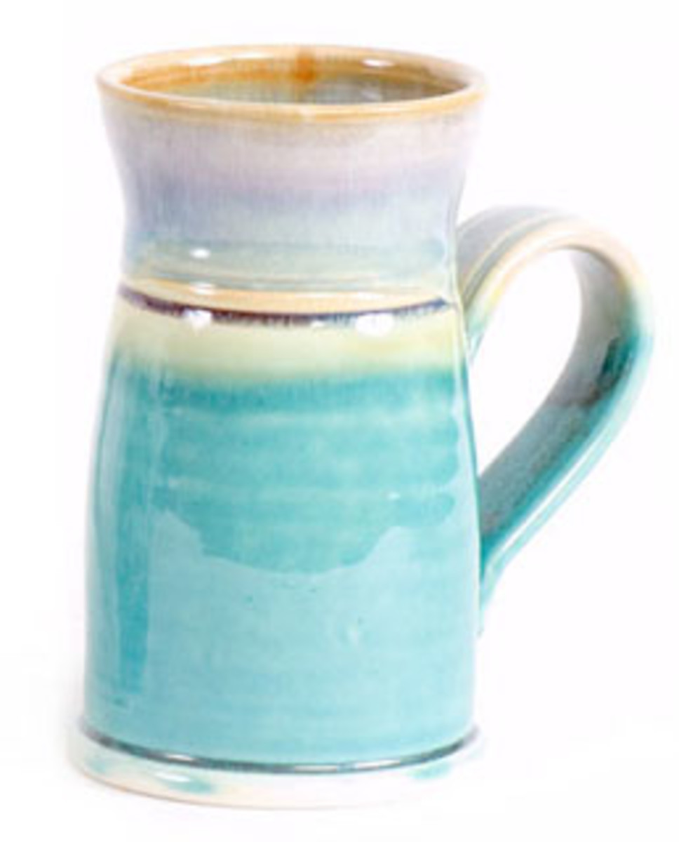 Hand Tooled Ceramic Coffee Mug Shown in Green Oribe & Purple