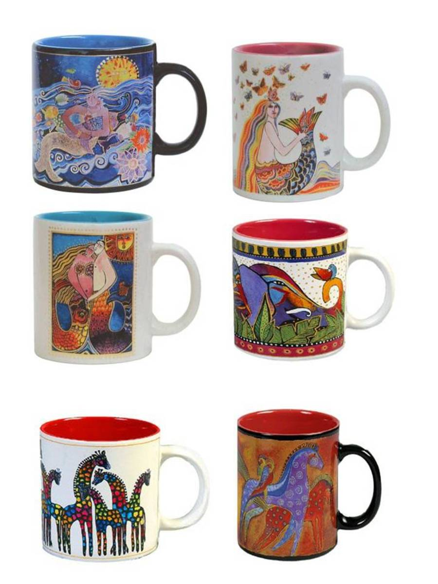 Artistic ceramic coffee mugs by artist Laurel Burch