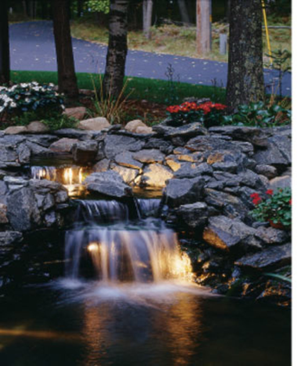 Lighted koi pond waterfall