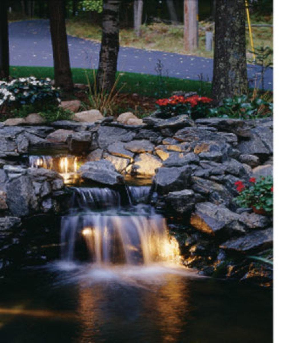 Lighted koi pond waterfall